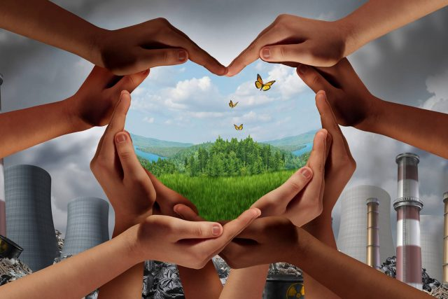 earth-day-climate-change-hands-pollution-1181043446